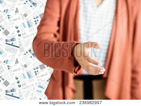 Woman mid section with hand out against document backdrop