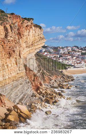 The Cliff On The Coast Of Atlantic Ocean In Nazare Coastline. Portugal