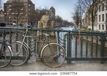 Amsterdam, Holland - 14 April 2018 Bridge Art Over Canal In Amsterdam, Holland . Bridge Displays Man