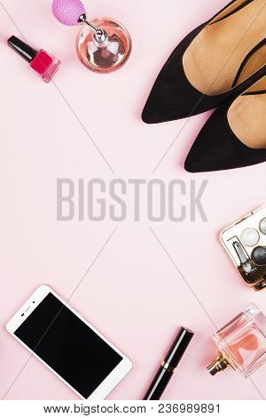 Women's Accessories - Shoes, Cosmetics, Perfume, Phone On Pink Background. Feminine And Fashion Back