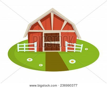 Red Wooden Barn With Fence On Green Lawn With Small Path And Chamomiles. Rural Capacious Building At