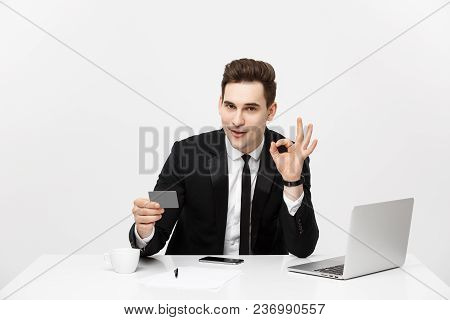Caucasian Office Man In Formal Suit And Tie Demonstrating Digital Money In Plastic Credit Card And S