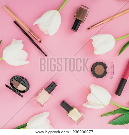 Frame Composition With Tulips Flowers And Cosmetics On Pink Background. Top View. Flat Lay Home Femi