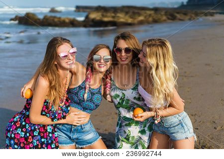 Group Of Attractive Young Women Embracing On Beach