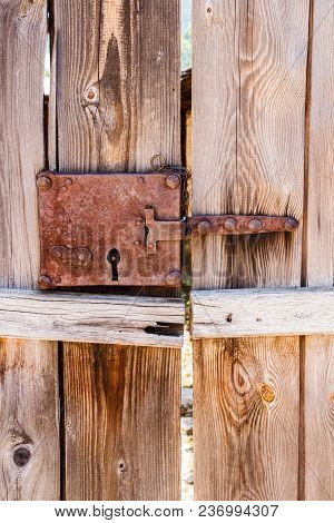 Close-up Of A Plank Door With Old Rusted Lock, Detail