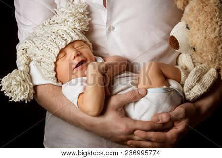 Father And Newborn Baby, New Born Kid Sleeping On Fathers Hands, Dad Embracing Happy Child Boy One M