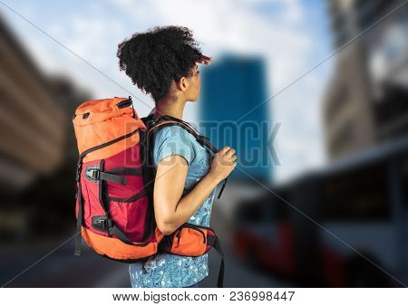 Millennial backpacker searching on blurry street