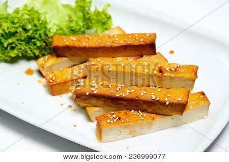 Grilled Fried Tofu On A Plate With Sesame And Green