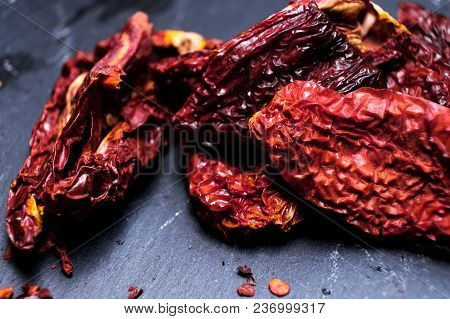 Red Dried Slices Of Tomato In Metal Bowl On Dark Background. Selective Focus. Copy Space. Homemade S