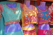 Sari Clothes India for women. Bazaar market in India. Bright saris are sold on the market in India. poster