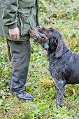 hunter with a dog at hunt poster