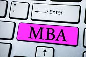 Text sign showing Mba. Conceptual photo Master of Business Administration Advance Degree After College Studies written Pink Key Button White Keyboard with copy space. Top view. poster