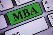 Word writing text Mba. Business concept for Master of Business Administration Advance Degree After College Studies written Green Key Button White Keyboard with copy space. Top view. poster