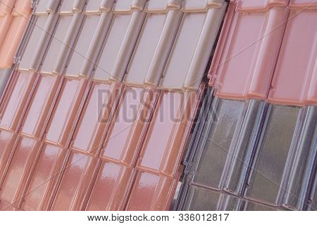 Samples Of Ceramic Roofing Tiles In A Warehouse Of A Roofing Materials Store. Modern Roof Made Of Me