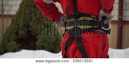 Worker in workwear. The installer of the roof. safety belt on the worker. poster