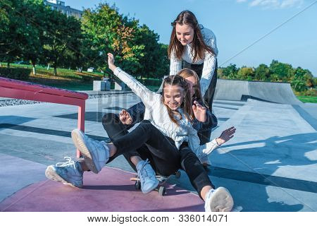 Three Teenage Girls Teenagers Ride Skateboard, Happy Have Fun Playing And Laughing, Summer Sports Gr