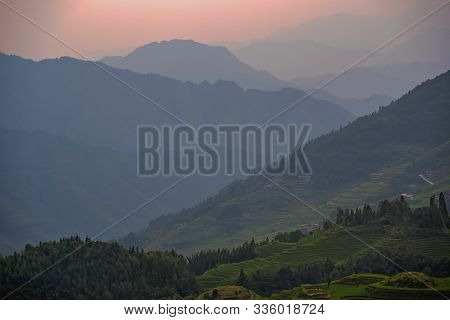 Sunset Over Seven Stars Accompany The Moon Cascading Layered Rice Terraces Forming Part Of Longji Ri