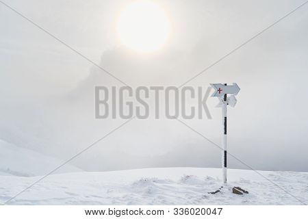 Blank Hiking Trail Marker With A Red Cross, During A Whiteout Blizzard In The Carpathians (baiului M