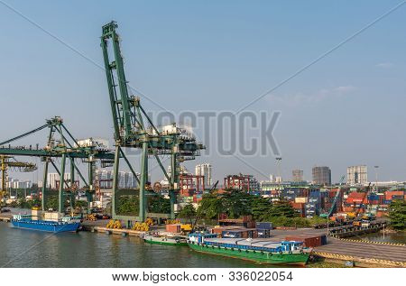 Ho Chi Minh City, Vietnam - March 13, 2019: Vict Port On Song Sai Gon River At Sunset. Three Barges