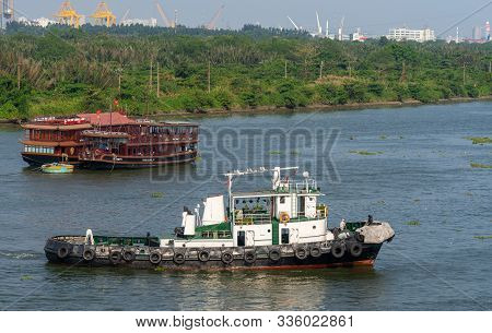 Ho Chi Minh City, Vietnam - March 13, 2019: Brown Wooden Tourist Restaurant Boats And White-black Tu