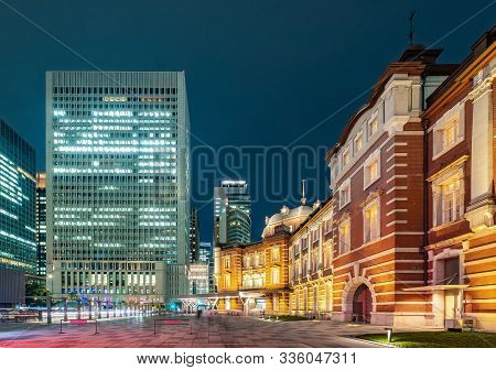 Tokyo city skyline at railway station surround by modern highrise building at twilight time.  Tokyo city, Japan. poster
