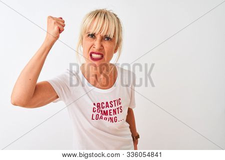 Middle age woman wearing fanny t-shirt with irony comments over isolated white background annoyed and frustrated shouting with anger, crazy and yelling with raised hand, anger concept