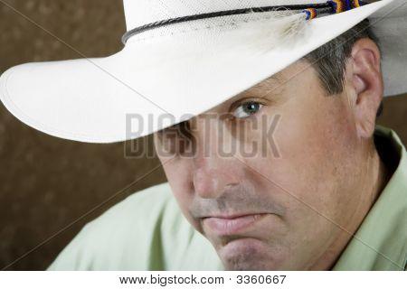 Man Under A Cowboy Hat