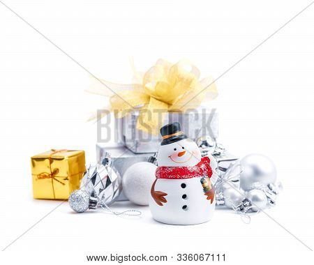 Merry Christmas And Happy New Year With Snowman Statuette And Silver Gift Boxes Isolated On White Ba