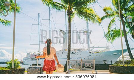 Cruise ship vacation travel tourist going aboard boat holiday with luggage suitcase. Woman passenger on Tahiti French Polynesia summer vacation banner.