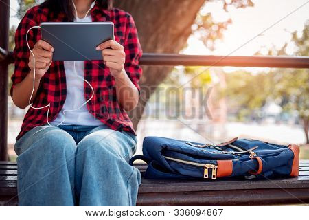 College Student Is Using Tablet, Watching Movie, Studying With Tablet, Searching Knowledge On Tablet