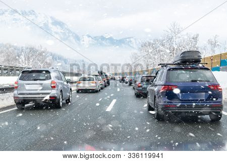 Winter Highway With Many Different Cars Stucked In Traffic Jam Due Ti Bad Weather Conditions. Vehicl