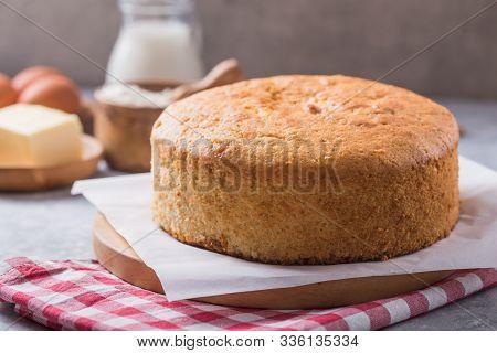 Sponge Cake. Homemade  Soft And Lite Delicious Sponge Cake With Ingredients: Eggs Flour Milk On Ston