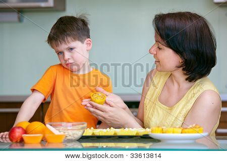 Cute little boy refuses to taste muffin