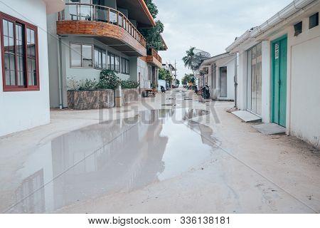 Maafushi Island, Maldives - November 26, 2019: Flooded Sandy Roads With Huge Puddles After A Rainsto
