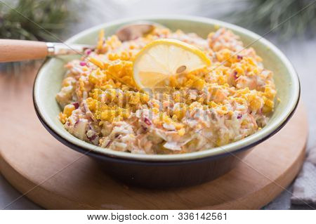 Christmas Or New Year Tuna Salad. Salad With Tuna, Corn, Onion, Raw Carrot, Eggs, In   Gray Plate On
