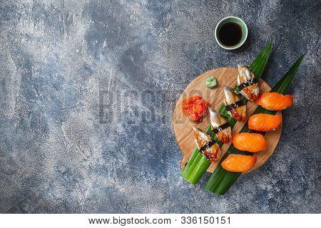 Sashimi Sushi Set On Wooden Board. Stone Background. Top View