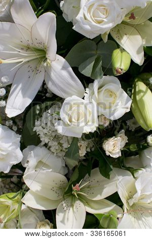wedding decor of white roses and lilies