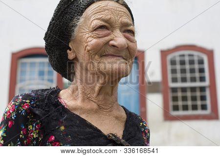 Diamantina, Minas Gerais, Brazil - January 25, 2016: Traditional Senior Woman In The Streets Of The