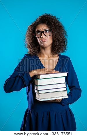 African Student Is Dissatisfied With Amount Of Homework And Books. Girl With Books, She Is Annoyed,