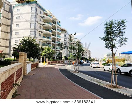 Rishon Le Zion, Israel  July 04, 2018: Residential Buildings And Plants In The Streets Of Rishon Le