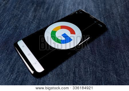 Odessa, Ukraine - October 26, 2019: Google App. Google Logo Visible On Smartphone Screen. Denim Back