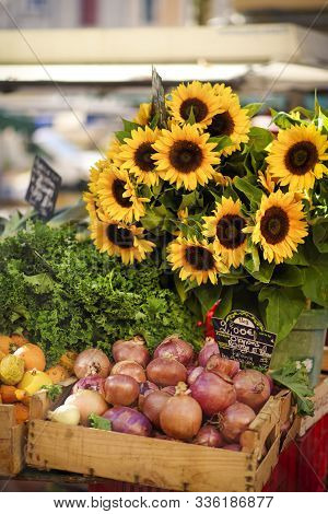 Sunflowers And Onion On The Old Fashioned Sunday Provencal Market In Aix-en-provence, Provence, Fran