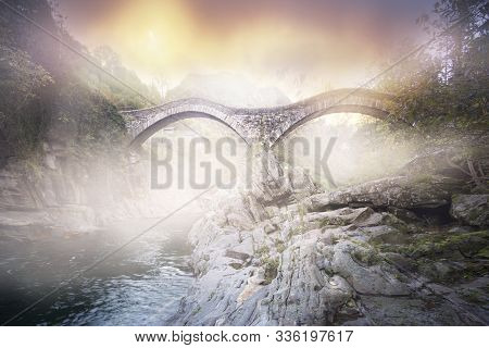 Attraction Of The Verzaska River Is The 17th Century Double-arched Roman Bridge - From One Of Its Be