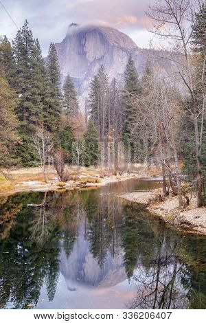 Half Dome Reflected Through The Merced River As Seen From Sentinel Bridge. Yosemite National Park, C