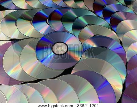 Background Texture: A Lot Of Computer Disks. Music Cds On A Black Background, Abstraction. Concept: