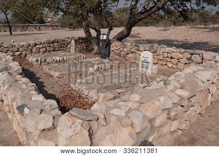 Sesfontein, Kaokoveld, Namibia - July 25 2019: Fort Sesfontein Cemetary With Three Graves Of Soldier