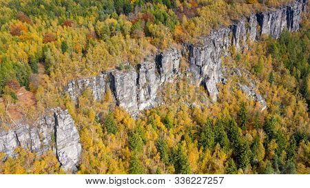 Natural Rock Wall In Autumn Colored Forrest, Tisa Rocks, Czechia. Aerial Shot.
