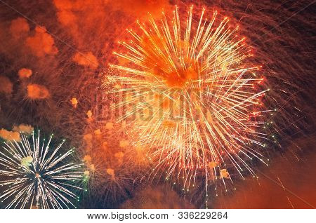 Inexpensive Fireworks, Over The City, Red Coloured. Bright And Shiny. Celebration Concept.