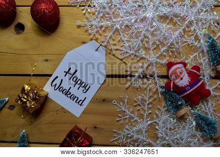 Happy Weekend Write On Label With Wooden Backgroud. Frame Of Christmas Decoration.