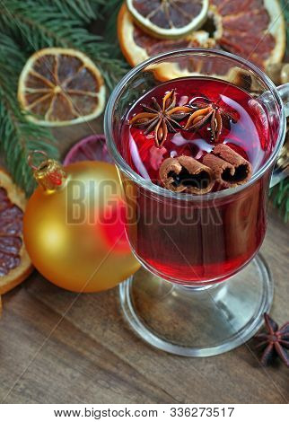 Golden Christmas Ball, Mulled Wine And Spices. Christmas Background. Mulled Wine In A Glass. Mulled